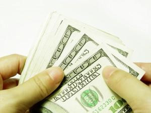 A stack of several 100 dollar bills